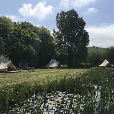Bell tents and pond